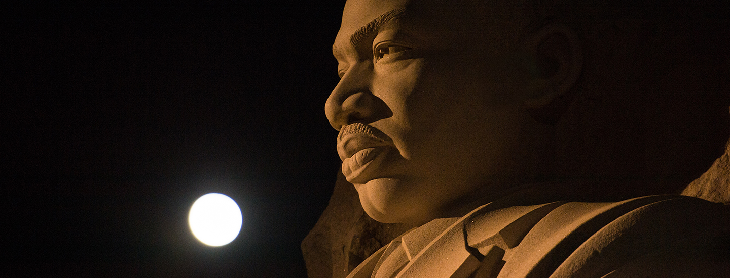The moon, or supermoon, is seen as it sets over the Martin Luther King Jr. Memorial on Monday, Nov. 14, 2016. A supermoon occurs when the moon's orbit is closest (perigee) to Earth. Early Monday morning, the moon was the closest it has been to Earth since 1948 and it appeared 30 percent brighter and 14 percent bigger than the average monthly full moon. Photo Credit: (NASA/Aubrey Gemignani)